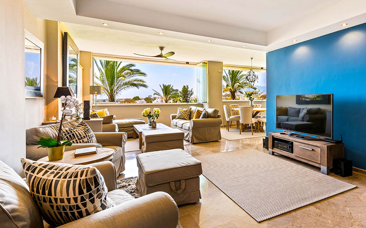 Classy contemporary living space with indoor outdoor living space of bi-fold windows in Costa del Sol