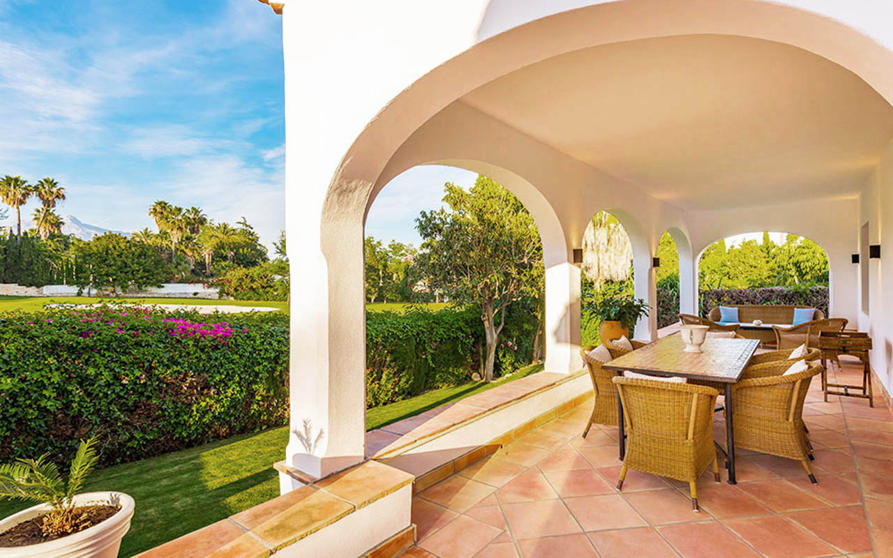 Classy Spanish terrace with arches and classic cane seating in Marbella