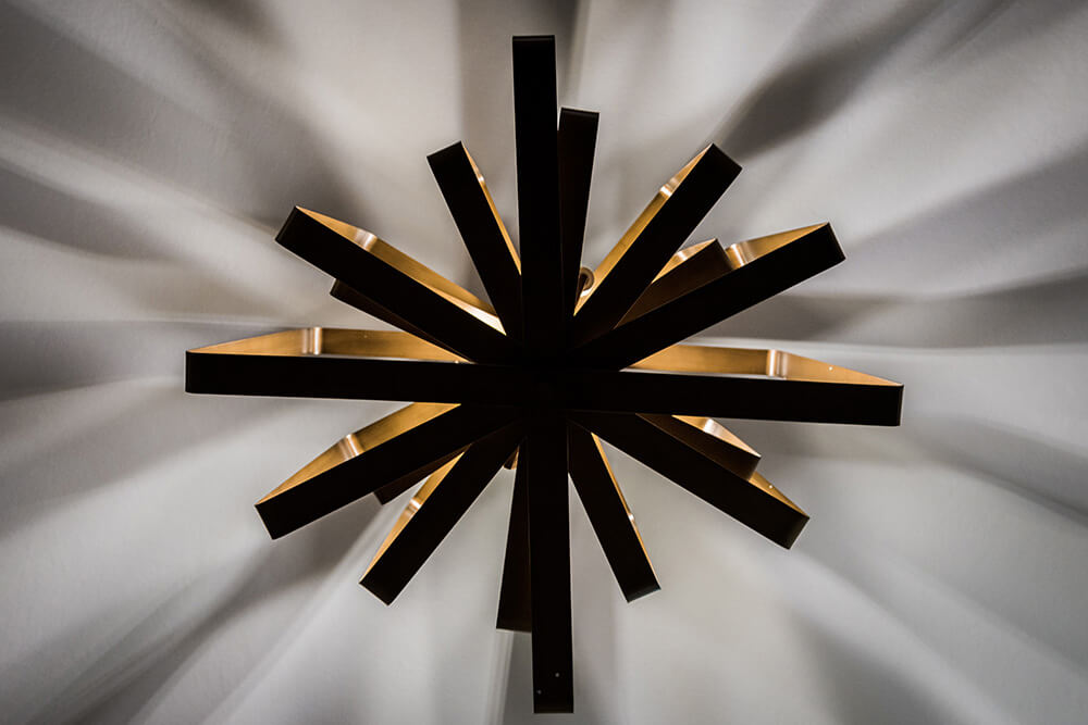 This ceiling fixture casts geometric shadows on the ceiling and walls