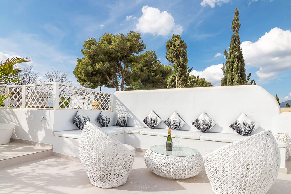 stylish white chill out zone on spanish rooftop
