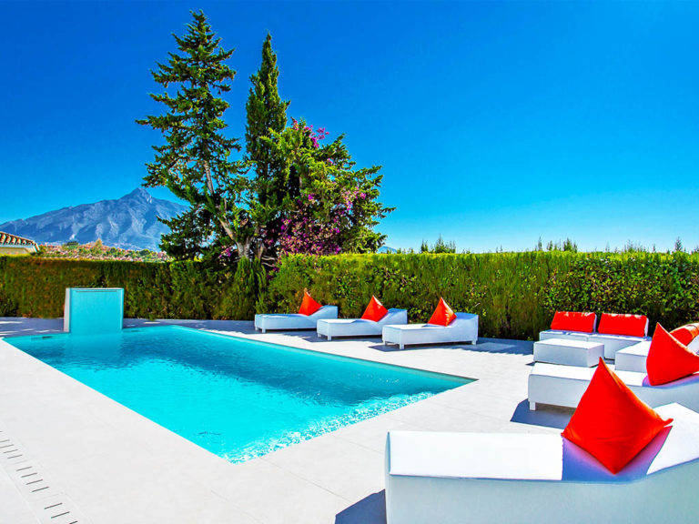 Divine pool next to Marbella mountain with luxury loungers