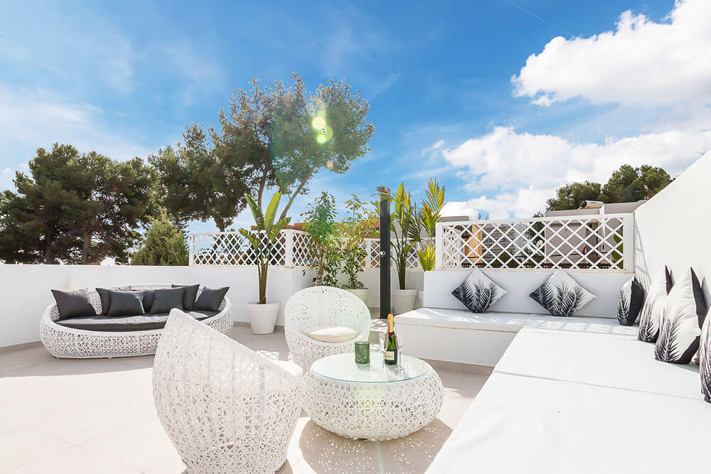 White quality outdoor furniture in Spanish relaxing rooftop with shower