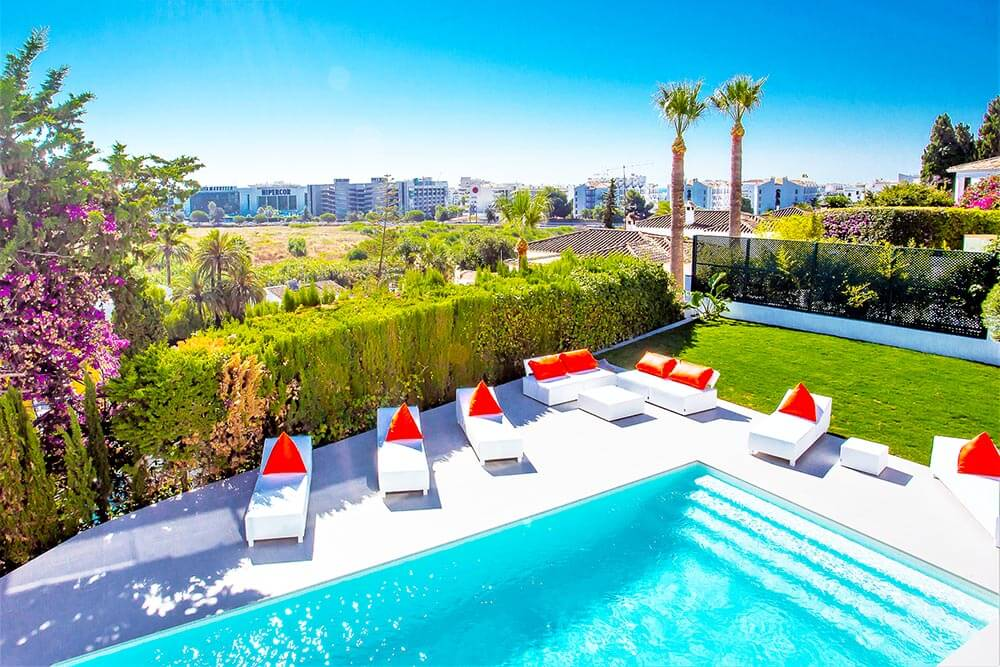 stylish pool relax zone sunlounges view in puerto banus marbella