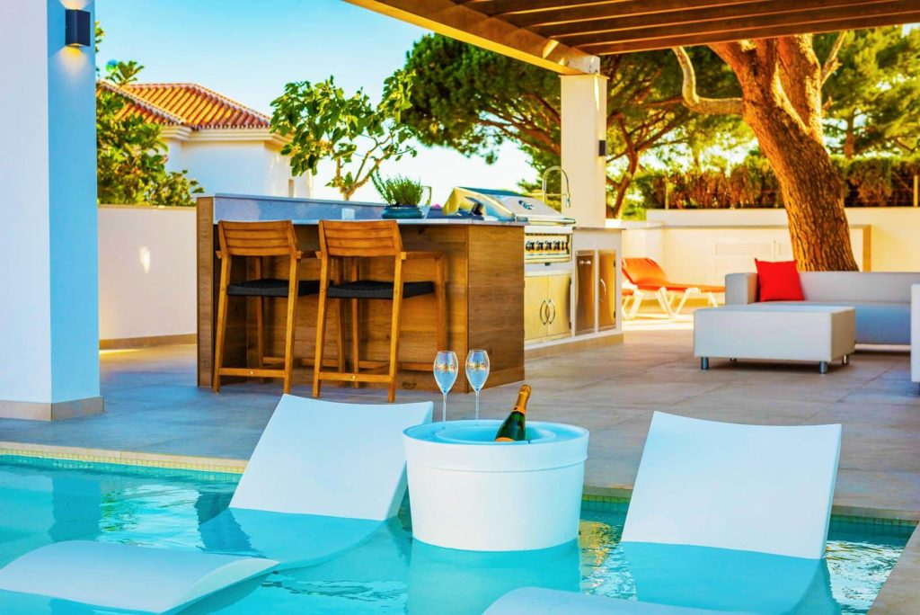 luxury pool chair with outdoor living in Marbella