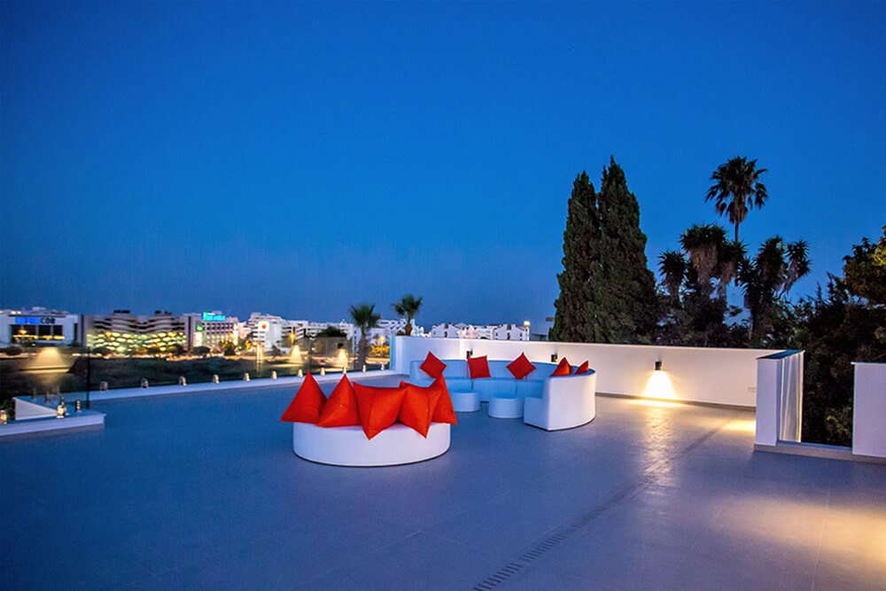 stylish rooftop in evening with views