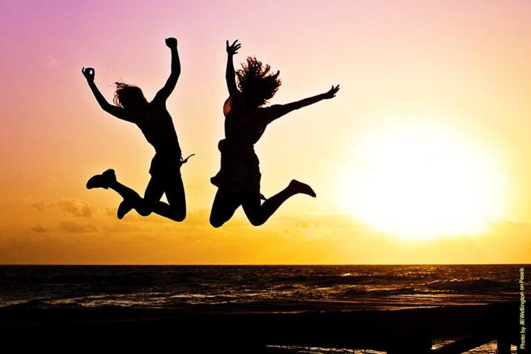 sunset beach jumping pexel