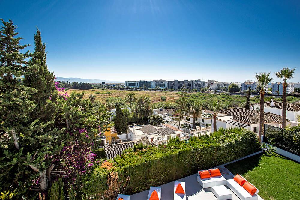 rooftoop view of relaxing poolside garden