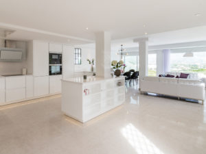 Modern white open plan living and kitchen in Marbella