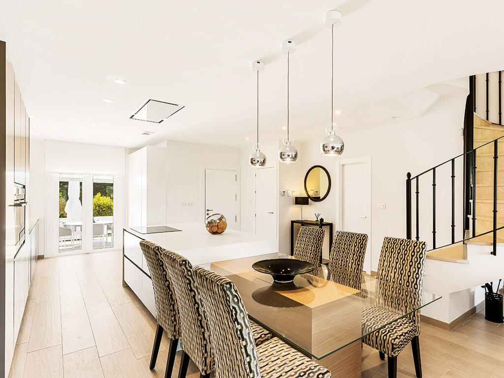 Contemporary kitchen and dinning with drop lights and kitchen island