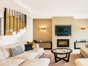 Stylish staircase and beige furniture La Quinta