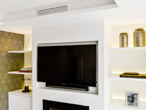 TV area with built in white shelves and bronze coloured details on Costa del Sol