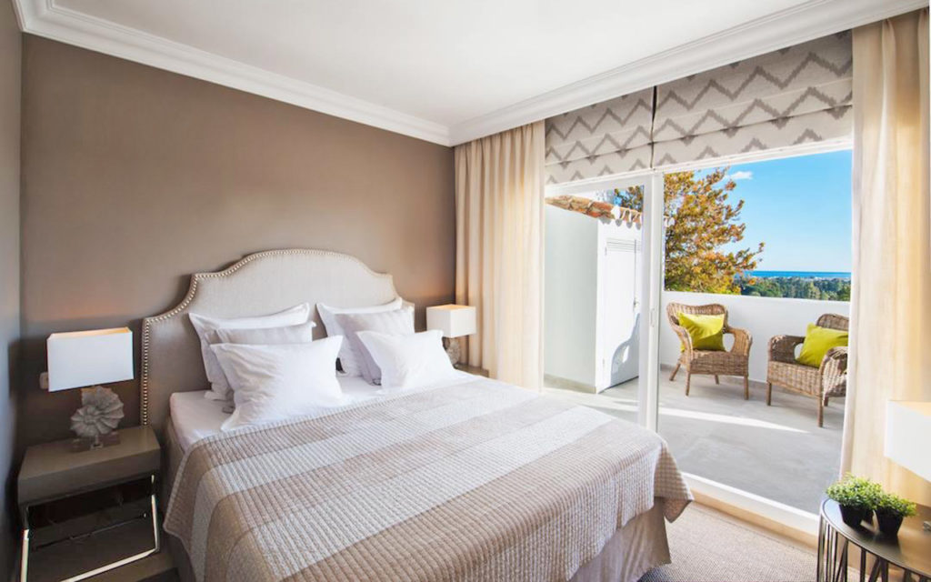 Stylish bedroom leading to balcony on the Costa del Sol
