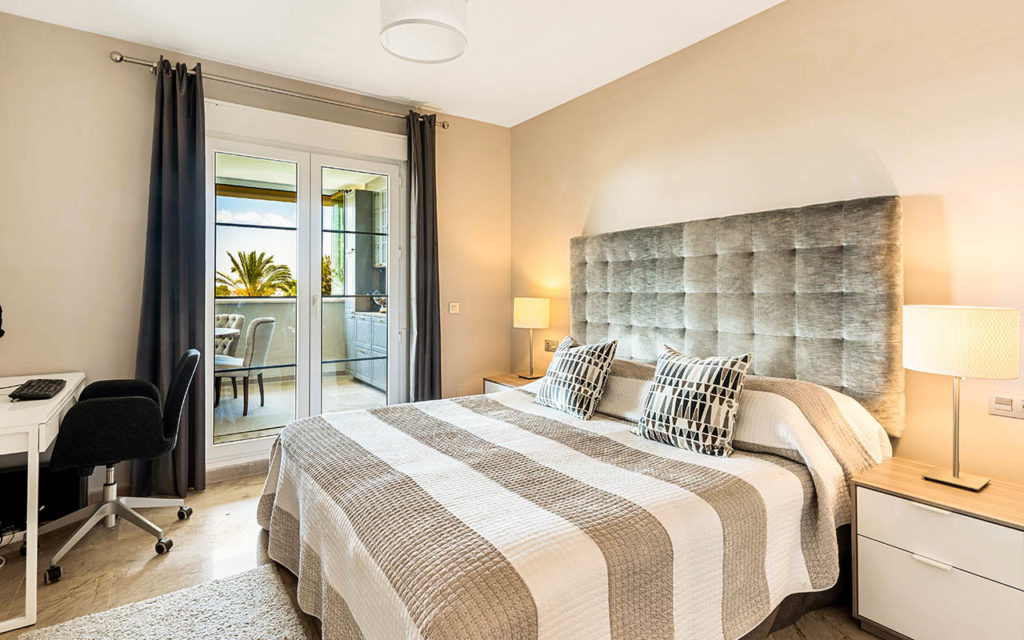 Contemporary bedroom with velvet bedhead in Costa del Sol