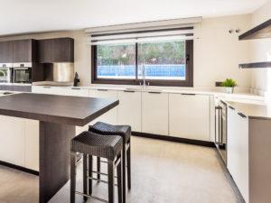 Modern white with dark timber kitchen in Marbella