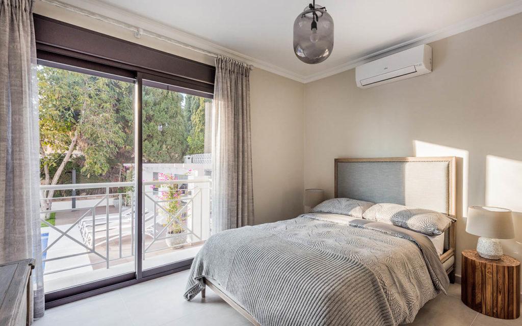 Classic grey bedroom with large aluminium windows in Marbella