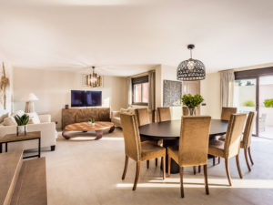Formal living space with high backed velvet chairs