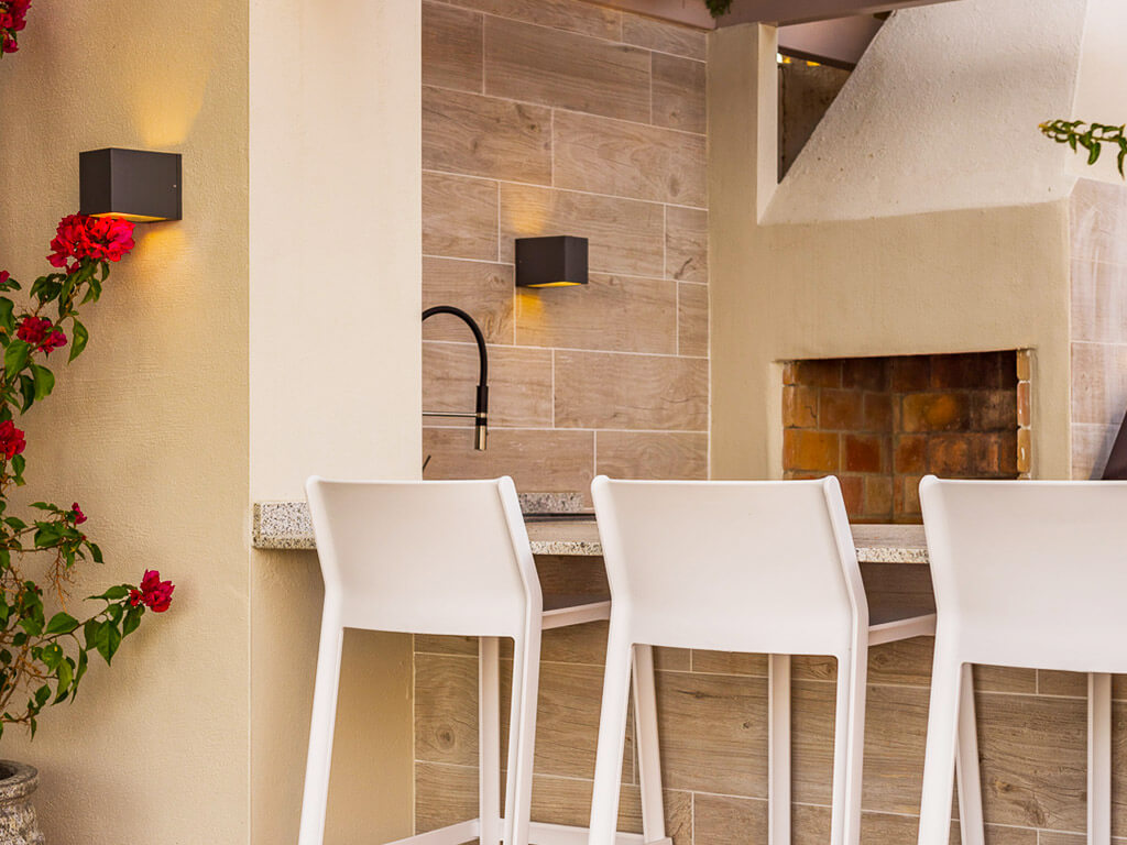 Outdoor pizza oven with bar stools in the Costa del Sol