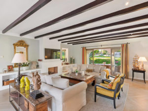 Contemporary rustic style living space with timber roof beams