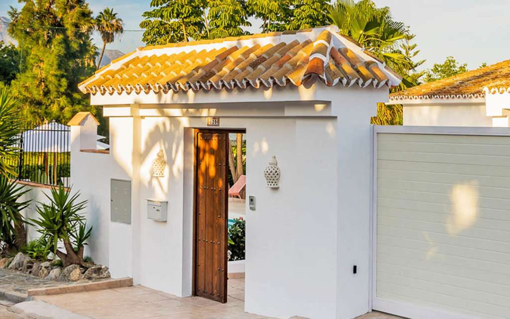 Traditional Andalusian property entrance wall and timber door