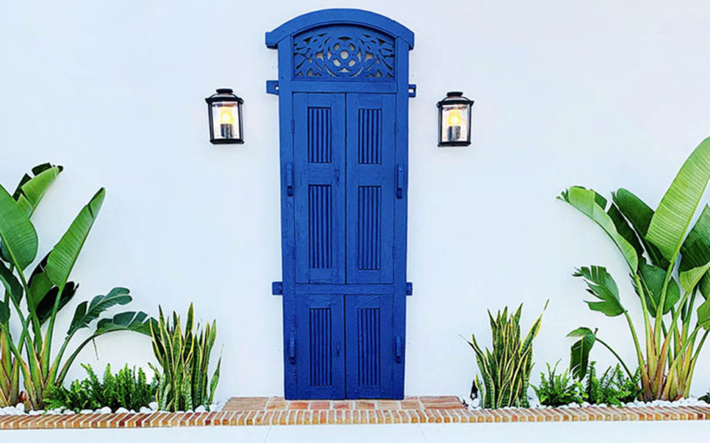 Classic Spanish blue carved timber door