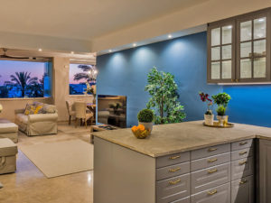 Stunning grey open plan kitchen with blue wall