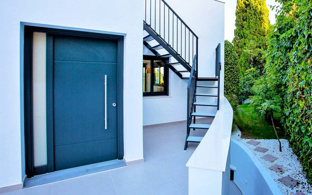 Wide modern entry door to apartment in Costa del Sol