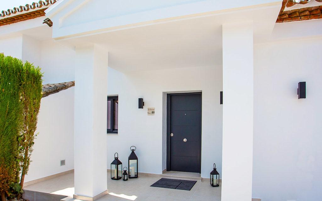 Modern villa entrance with black door in the Costa del Sol