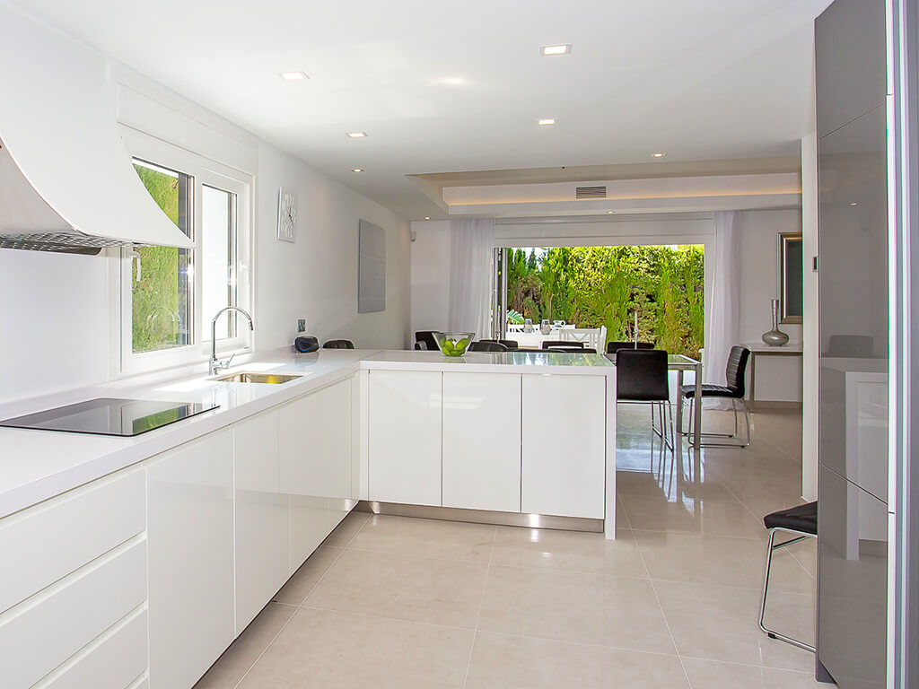 modern white kitchen looking to green terrace in the Costa del Sol