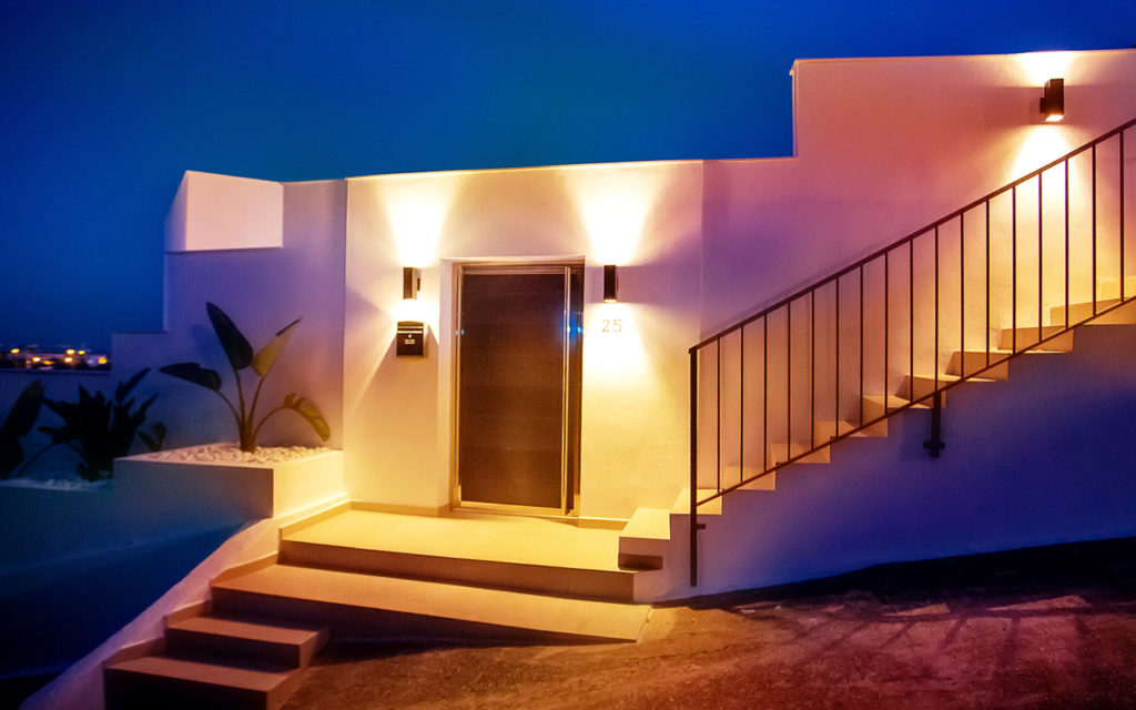 Simplistic modern entrance of building with lighting