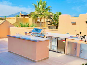 Spanish rooftop kitchen with barbeque and mountain views