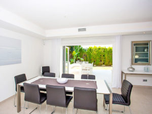 Modern black leather chair dinning area connected with outdoor terrace in the Costa del Sol