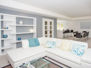 White, blue and grey lounge area in living room