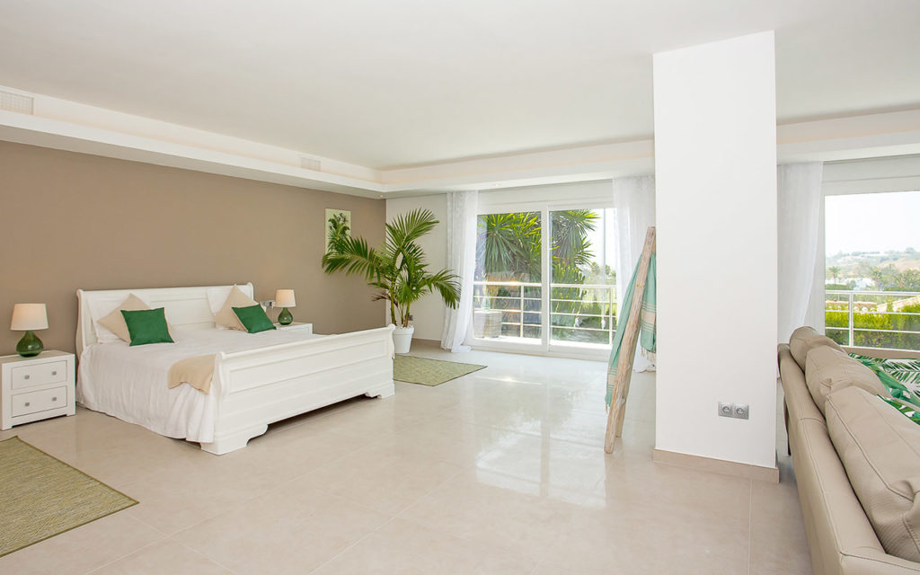 Large bedroom with lounge suite and balcony in Marbella