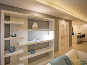 Soft living room lighting in white toned living space