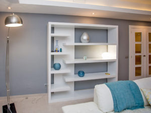 White built in shelves in white blue and grey living space