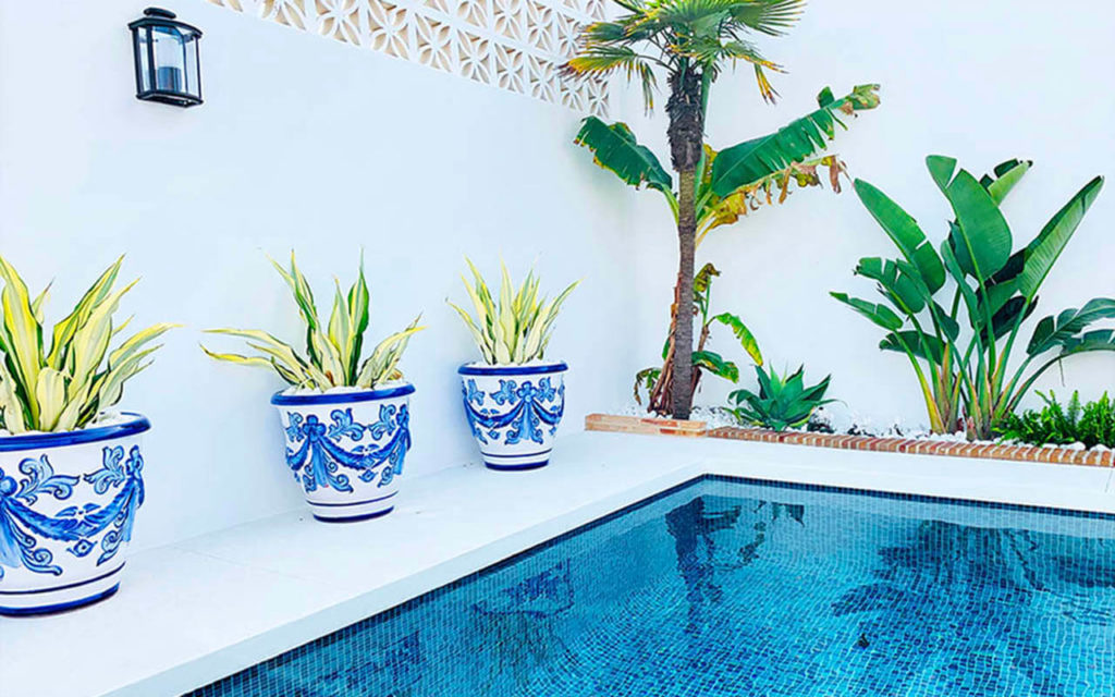 Andalusian pool with pots and landscaping in Marbella, Costa del Sol