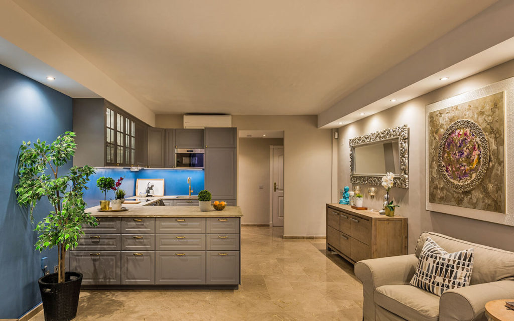 Unique kitchen with grey feature wall and unique decoration elements