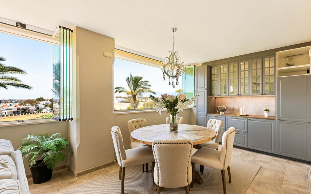 Grey built in cupboards and bifold windows with chandelier in Costa del Sol