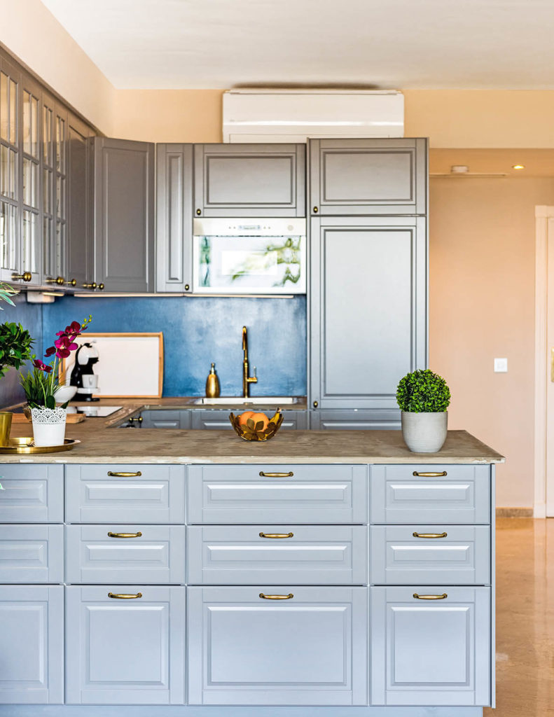 Unique grey kitchen with blue feature wall