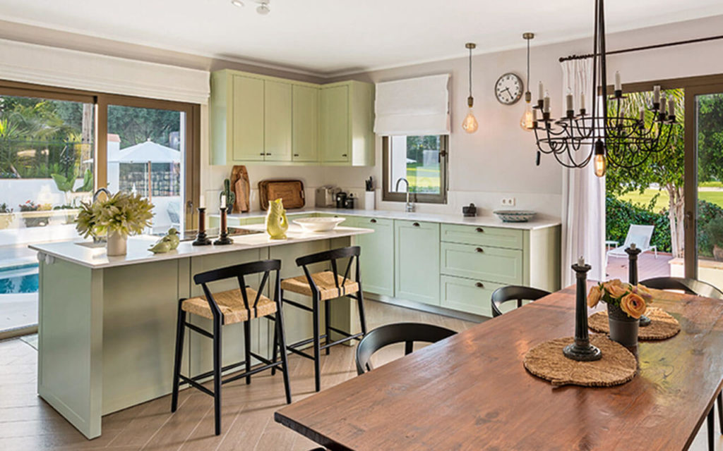 Classic country kitchen with mint cupboards and timber and black features