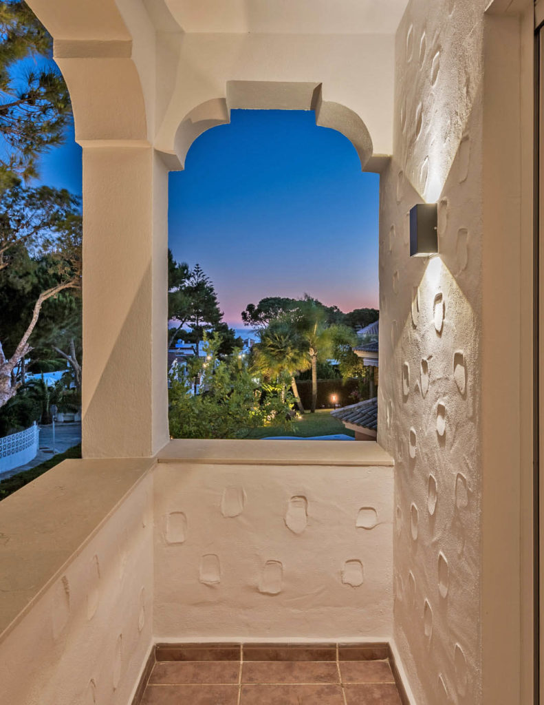 Moorish influenced arch and unique render overlooking the Costa del Sol in evening