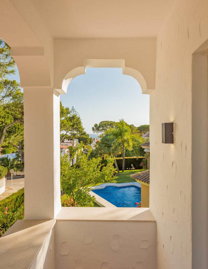Moorish influenced arch ocerlooking pool and Mediterranean in Costa del Sol