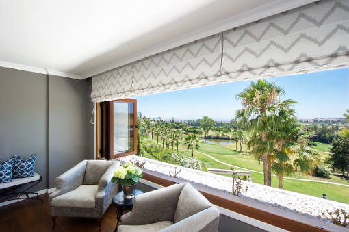 Room with wide open window overlooking golf course