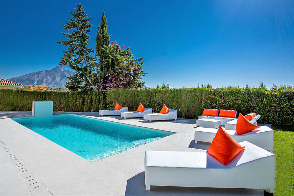 Stylish pool and leather loungers by ProMas in Puerto Banus