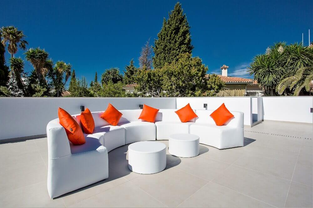 Refurnished rooftop with white leather curved sofa by ProMas in Puerto Banus