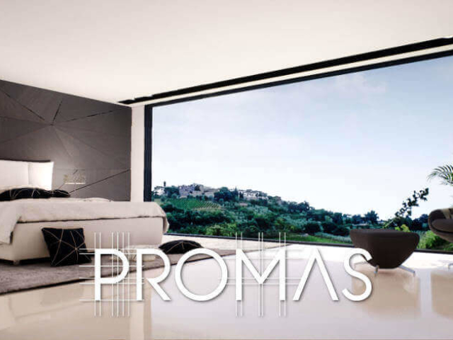 Sleek black and white bedroom with full window, black feature wall and high back chair in Marbella