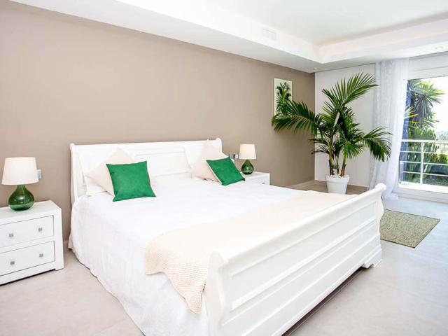 Stylish bedroom suite with green trims- interior design and refurbishment by ProMas