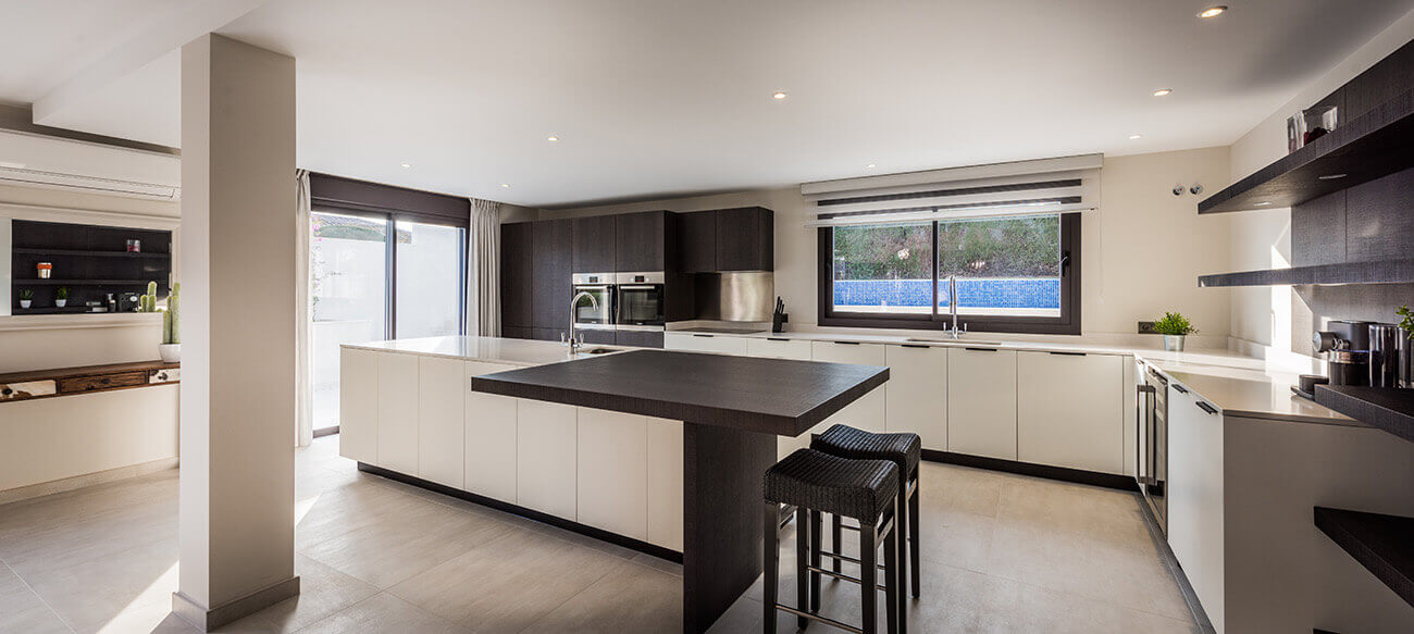 Stylish black and white modern kitchen custom design and built by ProMas in Marbella