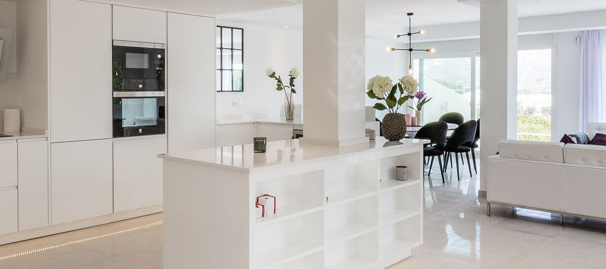 Stylish white open plan living and dinning area designed and built by ProMas in Marbella