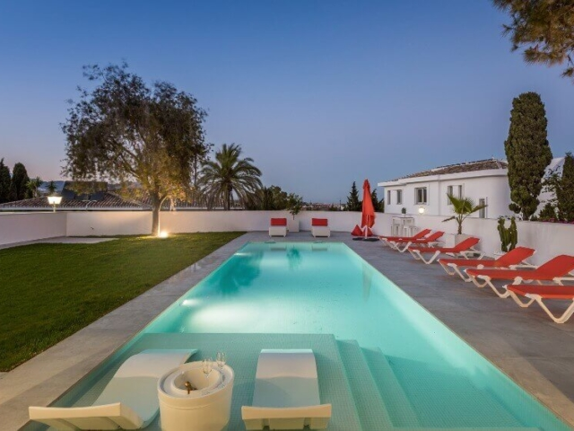 Stylish pool with in pool chair and sun loungers designed and built by ProMas In Mijas